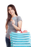 Young Asian woman with shopping bag and blank card Stock Photo