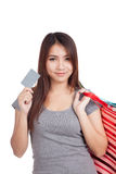 Young Asian woman with shopping bag and blank card Stock Image