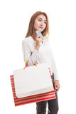 Young Asian woman with shopping bag and blank card. Stock Image