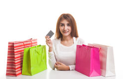 Young Asian woman with shopping bag and blank card. Stock Photography