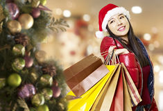 Young asian woman shopping for christmas Royalty Free Stock Photo