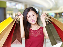 Young asian woman on a shopping spree Stock Images