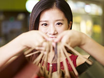 Young asian woman on a shopping spree Stock Photos