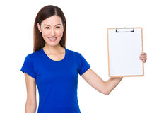 Young asian woman show with the blank page of clipboard. Isolated on white background Stock Photo