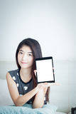 Young Asian woman show or display tablet with white blank screen Stock Images