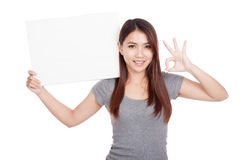 Young Asian woman show OK with blank sign Stock Photography