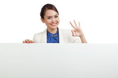 Young Asian woman show OK with blank sign Royalty Free Stock Photos