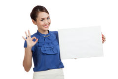 Young Asian woman show OK with blank sign Royalty Free Stock Photography