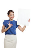 Young Asian woman show OK with blank sign Stock Image