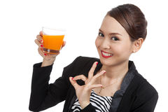 Young Asian woman show OK drink orange juice Stock Photo
