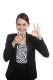 Young Asian woman show OK with a glass of drinking water Stock Images