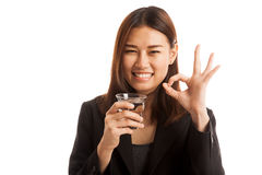 Young Asian woman show OK with a glass of drinking water. Stock Photography