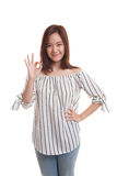 Young Asian woman show OK sign. Stock Photo