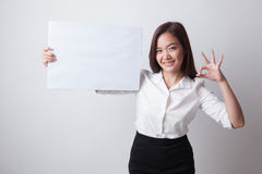 Young Asian woman show OK with  white blank sign. Stock Images