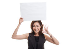 Young Asian woman show OK with  white blank sign. Stock Photography