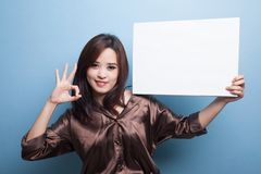 Young Asian woman show OK with  white blank sign. Stock Image