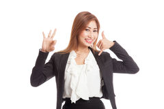 Young Asian woman show with phone gesture and OK sign Royalty Free Stock Images