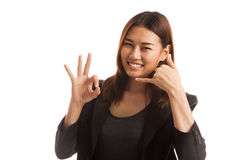 Young Asian woman show with phone gesture and OK sign. Royalty Free Stock Image