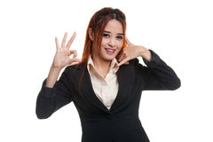 Young Asian woman show with phone gesture and OK sign. Stock Photo