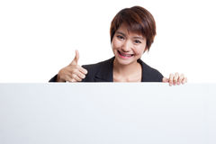 Young Asian woman show thumbs up with blank sign. Stock Image