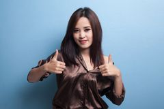 Young Asian woman show two thumbs up. Stock Photos