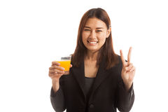Young Asian woman show victory sign drink orange juice. Royalty Free Stock Photo