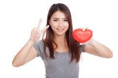 Young Asian woman show victory sign with red heart Royalty Free Stock Photo