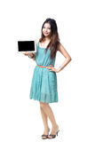 Young asian woman showing empty display of electronic tablet. Isolated over white with clipping path royalty free stock image