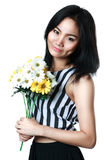 Young asian woman showing flower. Isolated over white Royalty Free Stock Image