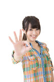 Young asian woman showing OK gesture Royalty Free Stock Photos