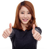 Young Asian woman showing thumb Stock Photos