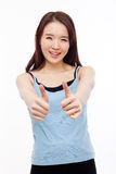 Young Asian woman showing thumb. Royalty Free Stock Image