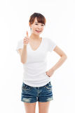 Young Asian woman showing thumb. Royalty Free Stock Images