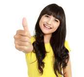 Young asian woman showing thumbs up Royalty Free Stock Photos