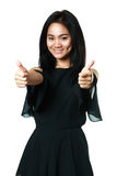 Young asian woman showing thumbs up. Isolated over white Royalty Free Stock Photos