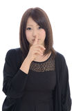 Young asian woman with silence gesture Stock Images