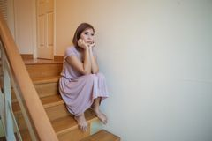 Young asian woman sits alone on stairs Stock Image