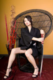 Young Asian Woman Sitting in Chair Stock Images