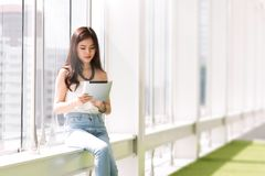 Young Asian woman Sitting at corridor. royalty free stock photography