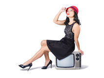 Young asian woman sitting on 70s tv set Royalty Free Stock Image