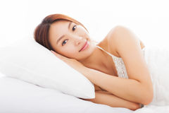 Young  asian woman sleeping in the bed Stock Photography