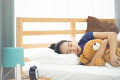 Young asian woman sleeping in bed,. Woman is too lazy to Wake up in the morning at home Royalty Free Stock Image