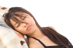 Young Asian woman sleeping with eyes shut Royalty Free Stock Photo