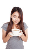 Young Asian woman  smell  coffee in a cup Stock Images