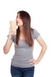 Young Asian woman smell drink in  tall plastic glass Royalty Free Stock Images