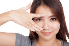 Young Asian woman smile peeking though her fingers Royalty Free Stock Photos