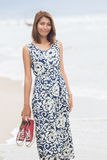 Young asian woman with smiling face wearing long dress standing Royalty Free Stock Images