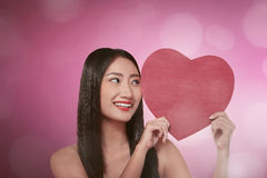 Young asian woman smiling with holding red heart Royalty Free Stock Images
