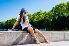 Young Asian woman smiling in the park Royalty Free Stock Photos