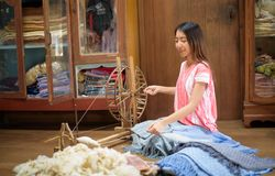 Free Young Asian Woman Spinning Sheep Wool Thread Royalty Free Stock Photos - 100047558